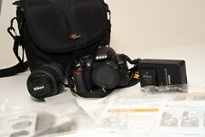 Nikon D D3100 14.2MP Digital SLR  (Kit w/ AF-S DX VR 55-200mm) 2462 shutter