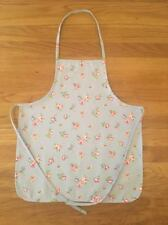 Handmade child's apron made from Clarke & Clarke blue rosebud fabric