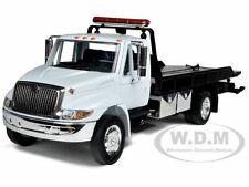 INTERNATIONAL DURASTAR 4400 FLAT BED TOW TRUCK WHITE 1/24 BY JADA 92351