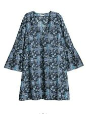 H&M blue patterned dress with trumpet sleeves