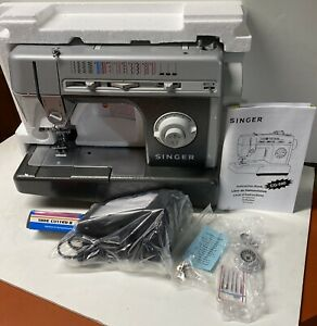 Brand New / Never Used Singer Sewing Machine model CG-590 w/ All Orig.  Extras