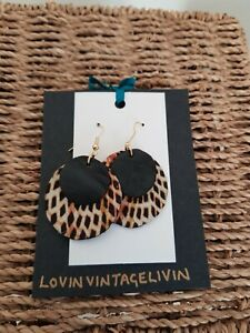 Recycled leather Earrings. Black leather with African wax print.