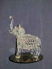 Hand Blown Glass Elephant With Gold Trim. Attached to a Circular Mirror