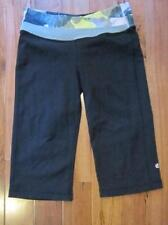 LULULEMON ASTRO CROPS SIZE 6 BLACK WITH black/citron TINTED CANVAS WAIST accents