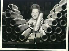 Women at war. Wwii. Press photograph with slugs on the verso.Inspecting Shells