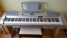 Yamaha Portable Grand DGX-500 keyboard with wooden stand, adjustable piano stool