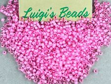 11/0 Round Toho Japan Glass Seed Beads #969- Crystal/Neon Carnation Lined 15g