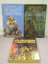 all signed by artist Michael Whelan,3 Fuzzy mmpbs by H. Beam Piper,1 1st,2 rprnt