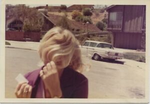 Vintage photo. CAMERA SHY WOMAN COVERS HER FACE W/ HER HAIR.