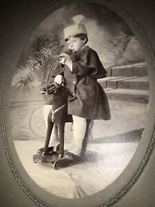 Late 1800's Cabinet Card Of Child W/Rocking Horse Toy With Wheels Horn Hat!