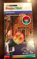 "LED LIGHT SHOW ""STARSPINNER"" PROJECTION CHRISTMAS DECOR RED/ GREEN NIB"