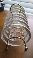 Vintage 8 piece set Fleur de Lis pattern glass drink coasters and metal stand