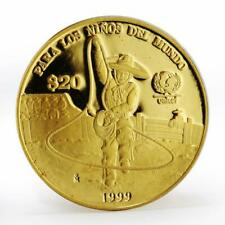 Mexico 20 pesos UNICEF Charrito cowboy child proof gold coin 1999