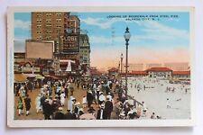 Old postcard LOOKING UP BOARDWALK FROM STEEL PIER, ATLANTIC CITY, N.J., 1929