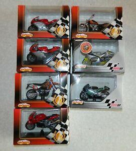 Lot 7 motos majorette 1:18 gp Augusta kawasaki Honda yamaha avec boite d'origine