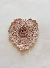 Hand crocheted vintage heart brooch with ceramic button and glass pearls.