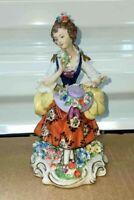 """Antique German Sitzendorf Porcelain Figurine, Woman w/ Flowers, 5.5"""" H."""