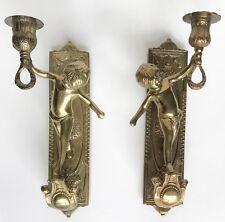Pair of brass cherub candleholder sconces