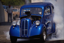 573067 An Old fashioned Hot Rod Tries To Hide In Its Own Smoke A4 Photo Print