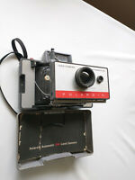 VINTAGE POLAROID AUTOMATIC 104 LAND CAMERA WITH INSTRUCTION BOOKLET & COLD CLIP