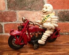 Michelin Man Bibendum on Red Motorcycle Vintage Cast Iron Toy