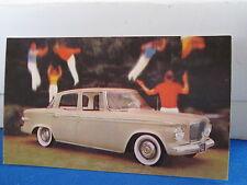 Studebaker 1961 lark 4dr  mint postcard  ***
