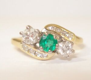 18ct Gold Emerald and Diamond Engagement Ring with Valuation for £1,600.00