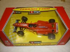 Burago, A Ferrari F310b, with working features,  boxed, old shop stock.