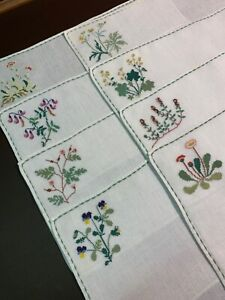 CHARMING SET OF 8 SWEDISH PLACEMATS - EACH  A DIFFERENT CROSS-STITCHED FLOWER