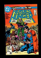 HEROES AGAINTS HUNGER (8.0) BATMAN SUPERMAN NEAL ADAMS DC (b018)