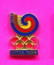 1988 SEOUL OLYMPIC PIN SEOUL LOGO OVER GOLD OLYMPIC RINGS OVER SEOUL 1988 PIN