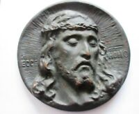 Antico medaglione in bronzo raffigurante il volto di Cristo