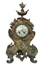 Pendule de cheminée en bronze doré  style Louis XV