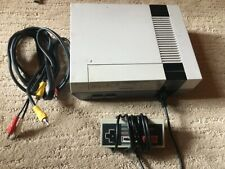 Original nintendo entertainment system NES console with 7 games