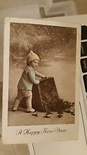 """Postcard Of """" New Year Card With Child Dumping Basket Of Good Luck Clover """""""
