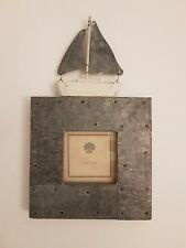 Picture frame feat. boat - metal on wood. Pic size 6.5 cm square. Frame 25x14cm