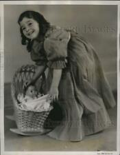 1938 Press Photo Marie rocks her doll cradle