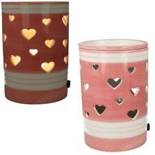 Candele e lumini rosa in cera per la decorazione della casa