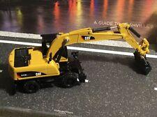 Diecast Masters HO Scale Caterpillar M318D Wheel Excavator - 1:87