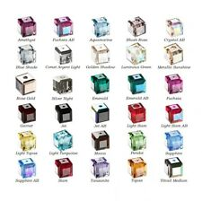 12 Swarovski® Crystal faceted cube 4x4mm Beads 5601. 12 faceted cube 5601.
