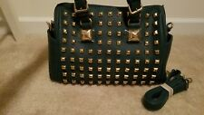 Green satchel with gold studs