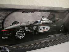 1:18 McLaren MP4-16, Mika Häkkinen, Figur & Zigaretten, Hot Wheels,NEU & OVP RAR