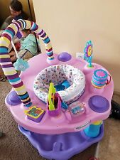 baby exersaucer and glider .
