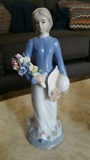 Porcelain Figurine of Young Lady Holding Hat and Flowers (Lladro style)