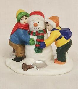 Lemax - Dept 56 - Other. Porcelain Figurine of Children building a snowman a/f