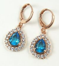 Women's 18 Carat Rose Gold Plated Ice Blue Crystal Huggie Drop Dangle Earrings