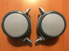 TWO (2) GREY PLASTIC SWIVEL CASTER WHEELS WITH BRAKE