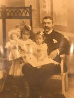 rppc postcard Father With Two Little Girls & Baby Doll On Bear Rug Mr Baron