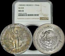 1985-Mo Mexico Libertad Silver 1 Onza NGC MS65 Toned Coin In High Grade