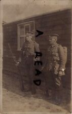 WW1 soldier Berkshire Regiment wearing full battle order outside barrack hut
